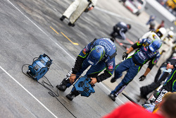 Lowe's Chevy crew members dry off their pit stall before the race