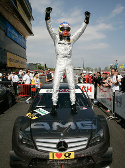 Race winner Paul di Resta celebrates