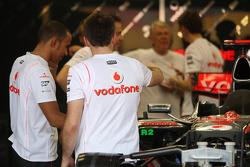 Lewis Hamilton, McLaren Mercedes with team members in the garage