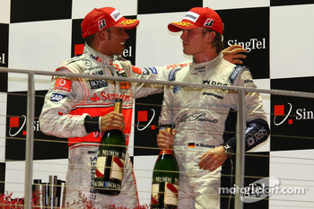Podium: champagne for Lewis Hamilton and Nico Rosberg