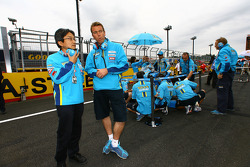 Suzuki team members on the starting grid