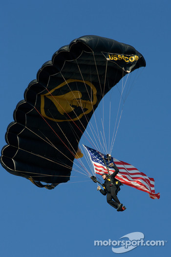 A skydiver brings the American flag