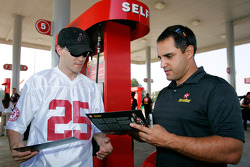 Juan Pablo Montoya signs autographs at a Texaco station in Talladega