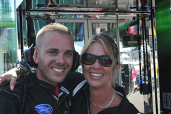 A crew member from Flying Lizard Motorsports poses with a charming lady
