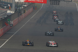 Mark Webber, Red Bull Racing, RB4 and Timo Glock, Toyota F1 Team