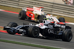 Kazuki Nakajima, Williams F1 Team leads Adrian Sutil, Force India F1 Team