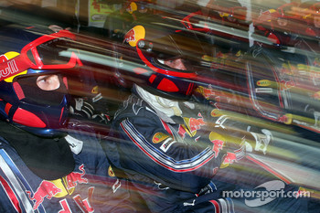Red Bull Racing crew members in the garage