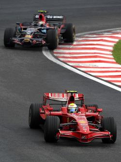 Felipe Massa, Scuderia Ferrari leads Sebastian Vettel, Scuderia Toro Rosso