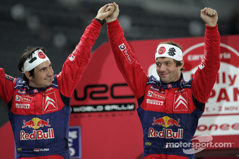2008 World Rally champions Sébastien Loeb and Daniel Elena celebrate