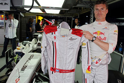 David Coulthard signs his race overall for Wings for Life