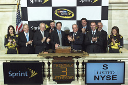 NASCAR Sprint Cup Series Champion Jimmie Johnson attends the opening bell with Miss Sprint Cup Anne-Marie Rhodes, team owner Rick Hendrick, Chairman and CEO of Lowe's Robert Niblock, Sprint's Chief Financial Officer Bob Brust, crew chief Chad Knaus and Mi