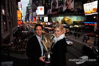 2008 NASCAR Srint Cup Series Champion winner Jimmie Johnson and his wife Chandra hold the championship trophy on top of Times Square Marquee at the Hard Rock Cafe