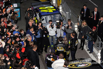 Photographers take pictures of NASCAR Sprint Cup Series champion Jimmie Johnson and crew chief Chad Knaus in Times Square outside the Hard Rock Cafe