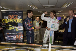 Jenson Button celebrates Scalextric victory over Mark Webber at the Race of Champions media preview