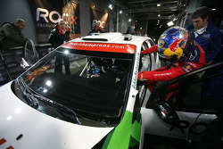 Sébastien Loeb climbs into a Ford Focus WRC 08