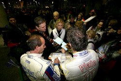 Terry Grant and Jason Plato sign autographs for their fans