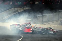 Lewis Hamilton shows off his McLaren Mercedes F1 car for the crowd