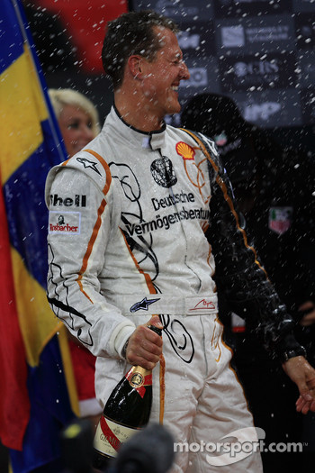 Podium: Michael Schumacher sprays champagne