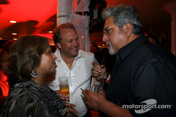 Robert Fearnley and his wife speak with Dr Vijay Mallya Force India F1 Team Owner at the Indian Empress Fly Kingfisher Closing Party