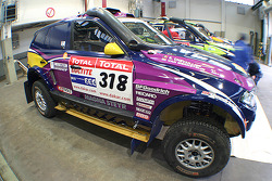X-raid team: the #318 BMW X3 CC of Peter van Merksteijn and Eddy Chevaillier in the garage