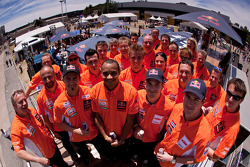 Cyril Despres, Alain Duclos, Jordi Viladoms and Marc Coma pose with KTM factory team members