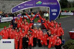 Podium: rally winners Sébastien Loeb and Daniel Elena celebrate with Citroen Total World Rally team members