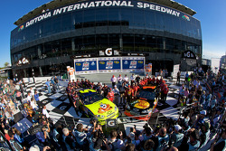 Pole victory lane: pole winner Martin Truex Jr., Earnhardt Ganassi Racing Chevrolet, with second fastest qualifier Mark Martin, Hendrick Motorsports Chevrolet, celebrate with their team