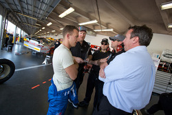 A.J. Allmendinger, Richard Petty Motorsports Dodge, talks with crew members