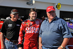Nelson Stewart, Tony Stewart, Stewart-Haas Racing Chevrolet, and racing legend Foyt pose with the #14 Stewart-Haas Racing Chevrolet
