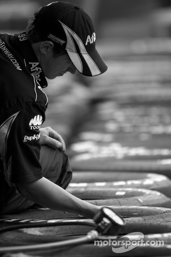 Roush Fenway Racing Ford crew member prepares wheels