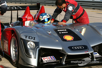 Mike Rockenfeller climbs into the car