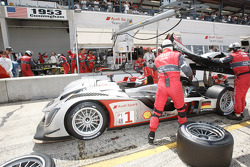 Pit stop for #1 Audi Sport North America Audi R15 TDI: Lucas Luhr, Mike Rockenfeller, Marco Werner