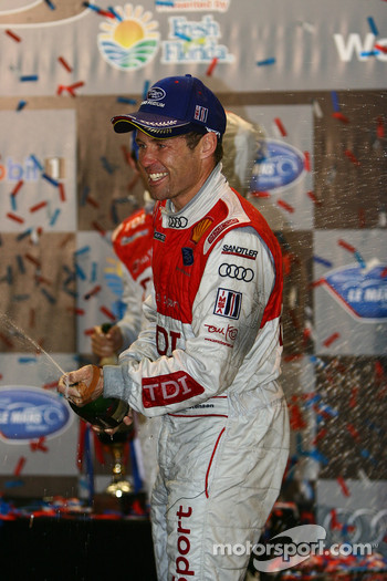 P1 podium: Tom Kristensen sprays champagne