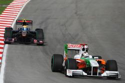 Adrian Sutil, Force India F1 Team and Sebastien Buemi, Scuderia Toro Rosso