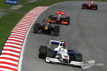 Nick Heidfeld, BMW Sauber F1 Team leads Sebastian Vettel, Red Bull Racing