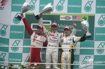 Vitaly Petrov celebrates his victory on the podium with Pastor Maldonado and Davide Valsecchi
