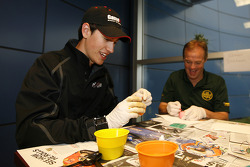 Joey Logano and Kenny Wallace dye Easter eggs as part of a driver and media contest
