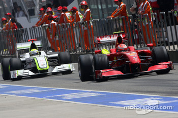 Kimi Raikkonen, Scuderia Ferrari and Jenson Button, Brawn GP