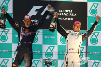 Podium: race winner Sebastian Vettel, Red Bull Racing, third place Jenson Button, Brawn GP