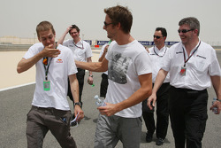 Sebastian Vettel, Red Bull Racing after his arrival on the track walk with his team gets overtaken by Jenson Button, Brawn GP on his walk with Rubens Barrichello, Brawn GP