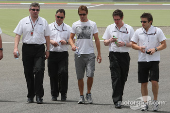 Jenson Button, Brawn GP on his walk with Ross Brawn Brawn GP Team Principal