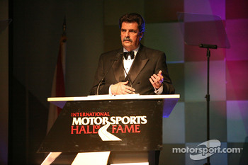 NASCAR President Mike Helton presents the first NASCAR Sprint Cup Series championship car owner, Raymond Parks, at the International Motorsports Hall of Fame