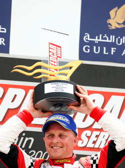 Race winner Johnny Herbert JMB celebrates on the podium