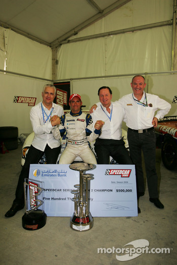 Gianni Morbidelli Palm Beach celebrates his championship success with Simon Azzam, CEO Union Properties, Luciano Secchi WIND Group and Claudio Berro Speedcar Series Operations Director