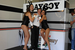 Lucio Cecchinello celebrates the fourth place of Randy De Puniet in charming company