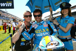 Loris Capirossi, Rizla Suzuki MotoGP and his umbrella girl