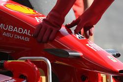 A Ferrari mechanic with KERS cloves