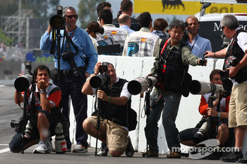 Photographers waiting at the end of the pitlane