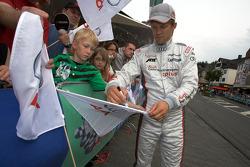 Matthias Ekström signs autographs