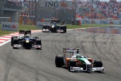 Giancarlo Fisichella, Force India F1 Teamleads Sebastien Buemi, Scuderia Toro Rosso